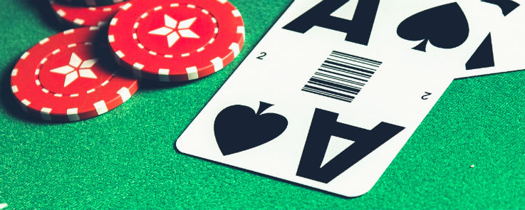 Ace of Spades on a blackjack table with casino chips