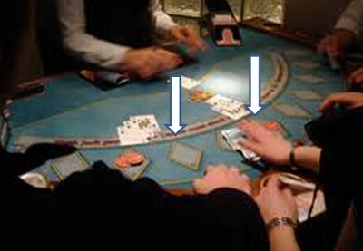 blackjack table with players