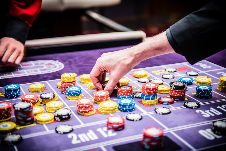 Betting on a roulette table at the casino
